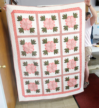Don Knight   The Herald Bulletin<br /> Peggy Sanqunetti created this Ohio Rose quilt and entered it into the Redbud Quilt Guild biannual show on Wednesday. Entries will be judged on Thursday and on display at The Anderson Center for the Arts on Friday and Saturday.
