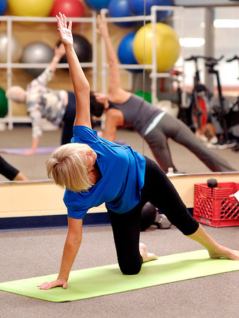 John P. Cleary | The Herald Bulletin<br /> Judy Tinch goes through the movements of the Warrior series during her yoga class at White River Health Club.