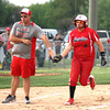 Chris Martin for THB<br /> Frankton Head Coach Jeremy Parker congratulates Tia Sharp as she rounds third base after a home run Monday in a loss to Madison-Grant