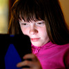 John P. Cleary | The Herald Bulletin<br /> Highland Middle School 6th grader Lilly Merrill is washed with the glow of her iPad as she works doing her reading assignment.