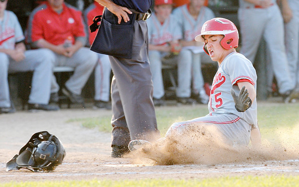 Don Knight | The Herald Bulletin<br /> Frankton's Bryce Mallernee slides safely into home plate to put the Eagles up 1-0 over Winchester during the baseball sectional at Frankton on Thursday. To view or buy this photo and other Herald Bulletin photos, visit photos.heraldbulletin.com.
