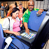 John P. Cleary | The Herald Bulletin<br /> Election day poll Judge Patricia Santiago listens as technician Dwayne Davis explains the voting machine and how the ballot appears on the screen during training for poll workers last week for Tuesdays primary election.