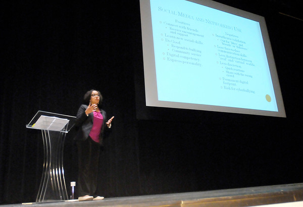 Don Knight | The Herald Bulletin<br /> Janet Kamiri, adolescent health coordinator for the Social Health Association of Indiana, talks about the positive and negatives of social media use by teens during a Cyber Safety program for parents at Pendleton Heights on Wednesday.