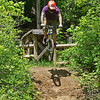 "Experienced mountain biker Justin Graham takes flight off of ""The Pier"" on the expert trail at the Rangeline Nature Preserve."