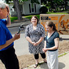 "John P. Cleary | The Herald Bulletin<br /> WRTV Meteorologist Kevin Gregory interviews Catlin Humes and her mother Lisa Hiday after Lisa had won a sweepatakes the station ran during May and won a 80"" television that Gregory delivered to their house Wednesday."