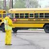 Don Knight | The Herald Bulletin<br /> Anderson Auxiliary Police wear rain gear while directing traffic as busses leave at the end of the school day at Anderson Elementary on Wednesday. The forecast for the rest of the week calls for below average temperatures and more rain chances.
