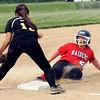 John P. Cleary | The Herald Bulletin<br /> Wapahani's Karli Conwell slides safely into third base as Lapel third baseman Katelyn Willis just gets the ball after Conwell got a hit and advanced on a error  in the sixth inning.