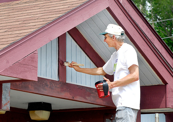 John P. Cleary   The Herald Bulletin<br /> Tom Corda paints the trim areas of the Shadyside lake Activity Center Tuesday afternoon.  Members of the Anderson Road Runners, which Corda is,   help the Parks Department by volunteering to do some of the maintenance on the facility.
