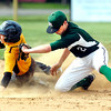 John P. Cleary | The Herald Bulletin<br /> Pendleton Heights shortstop Justin Kirkpatrick, right, puts the tag into the back of Alexandria's Logan Clark at second base as Clark attempted to steal the base and was tagged out.
