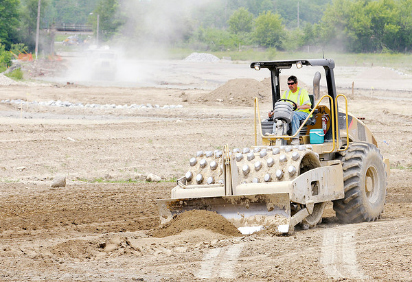 Don Knight | The Herald Bulletin<br /> Construction crews work on an extension of 29th street to 32nd street. The city council approved a request for rezoning property on the northwest corner of 32nd Street and Scatterfield Road.