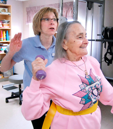 John P. Cleary   The Herald Bulletin<br /> ManorCare Health Services Occupational Therapist Nancy Helder works with patient Theresia Scheide on her balance, strength, and coordination during Scheide's session Monday afternoon.
