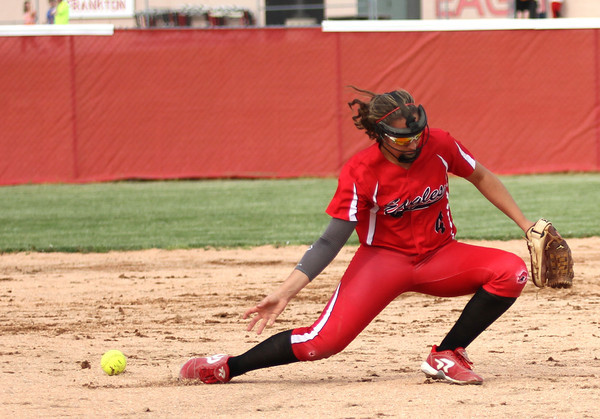 Chris Martin for THB<br /> Frankton's short stop Caitly Clark has a ground ball go just under her glove in a loss Monday as Frankton hosted Madison-Grant