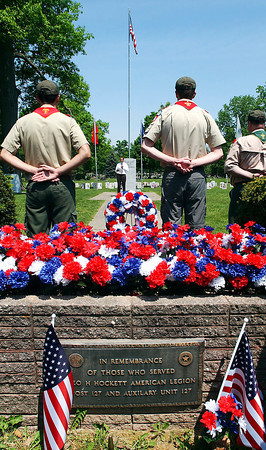 John P. Cleary | The Herald Bulletin<br /> The veterans section of Maplewood Cemetery was decorated for the Memorial Day Observance hosted by Boy Scout Troop 301 held Monday. Here guest speaker Andrew Brinkworth addresses those gathered for the service.
