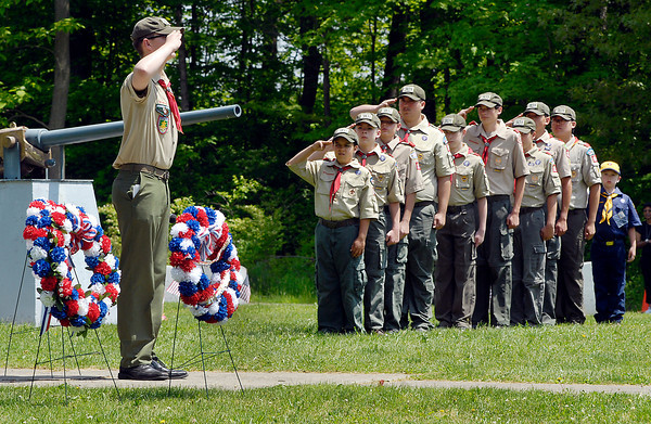 John P. Cleary   The Herald Bulletin<br /> Boy Scout Troop 301, chartered by St. Ambrose Church, hosted the Memorial Day Observance Monday at Maplewood Cemetery in the veterans section. Here they stand at attention and salute as memorial wreaths are placed during the service.