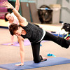 John P. Cleary | The Herald Bulletin<br /> Instructor JoAnn Hutchins leads her yoga class through the Warrior series during her yoga class at White River Club this past week.