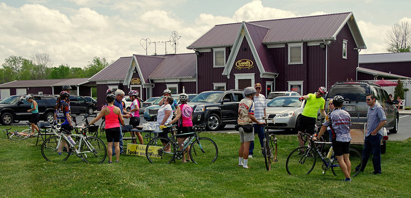 Participants in the Anderson CycloFemme Mother's Day Bicycle Ride take a break at Good's Candy Shop.