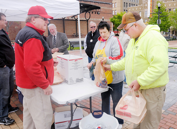 Don Knight   The Herald Bulletin<br /> Todd Davis buys two meals during Chickens for Charity, a fundraiser by the Anderson Noon Lions Club with proceeds benefiting the Diabetic Education Committee.