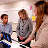 John P. Cleary | The Herald Bulletin<br /> Highland Middle School 6th grader Mikle Saxon explains to Indiana State Superintendent of Public Instruction Glenda Ritz how iPads are used in the iLit Reading program being used at the school as his  English teacher, Milissa Crum, looks on.