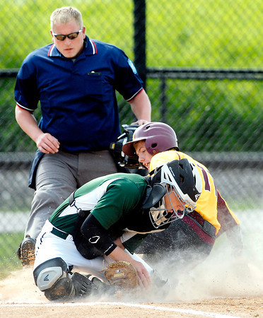 John P. Cleary   The Herald Bulletin<br /> Pendleton Heights catcher Noah Etchison traps the ball as Alexandria's Drew Johnson slides into home as the umpire waits to make the call of safe in first inning action of their game Monday evening.