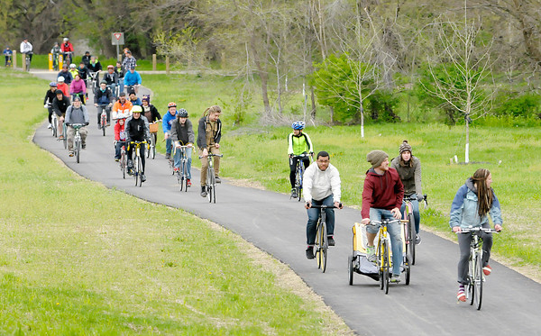 Don Knight | The Herald Bulletin<br /> Cyclists ride east on the city's new White River trail as Mayor Kevin Smith hosted a four mile bike ride to kick off National Bike Month. To view or buy this photo and other Herald Bulletin photos, visit heraldbulletin.smugmug.com.