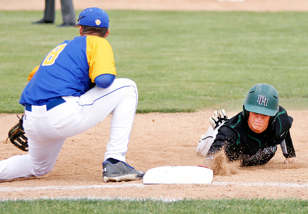 Chris Martin | For The Herald Bulletin<br /> Pendleton's Logan Robertson slides safely back to first base on an attempted pick off play Thursday in a sectional loss to Greenfield-Central. To view or buy this photo and other Herald Bulletin photos, visit photos.heraldbulletin.com.
