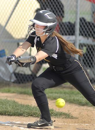 John P. Cleary | The Herald Bulletin<br /> Lapel's Emily Cline lays down a bunt.