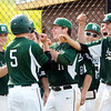 John P. Cleary | The Herald Bulletin<br /> Pendleton Heights Noah Etchison, #5, gets fist-bumps from his teammates after hitting a 2-run homerun in the second inning against Alexandria.