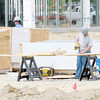 Don Knight | The Herald Bulletin<br /> This week contractors plan to work on the building facades and begin ground work for a final base that is required before the lots can be paved at the new Myers and Ford Autoworld on Scatterfield.