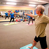 John P. Cleary | The Herald Bulletin<br /> Instructor JoAnn Hutchins, far left, leads her yoga class at White River Club this past week.
