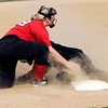 John P. Cleary | The Herald Bulletin<br /> Wapahani's Karli Conwell tags out Lapel's Hannah Harless at third base after she tried to stretch a double into a triple in the third inning of their sectional game Monday.
