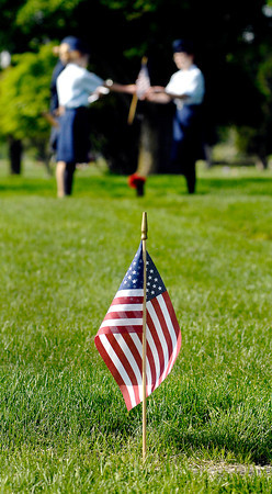 John P. Cleary | The Herald Bulletin<br /> Anderson Preparatory Academy students are spending three days placing American flags on the graves of deceased members of the military in Anderson Memorial Park.