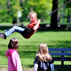 John P. Cleary | The Herald Bulletin<br /> Liberty Christian 2nd grader Miley Sylvia, 8, talks to her classmates as she plays at the playground during a end-of-year field trip to Mounds State Park Wednesday for the school's 2nd graders.