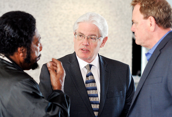 John P. Cleary | The Herald Bulletin<br /> Anderson Mayor Thomas Broderick Jr., center, talks with Rev. Wayne Redding and Board of Public Works Chairman David Eicks recently.