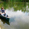 Don Knight | The Herald Bulletin<br /> James Bushen and his son Gavin fish from a canoe in the pond at Falls Park in Pendleton on Tuesday. The National Weather Service is forecasting a daily chance of rain through the weekend.
