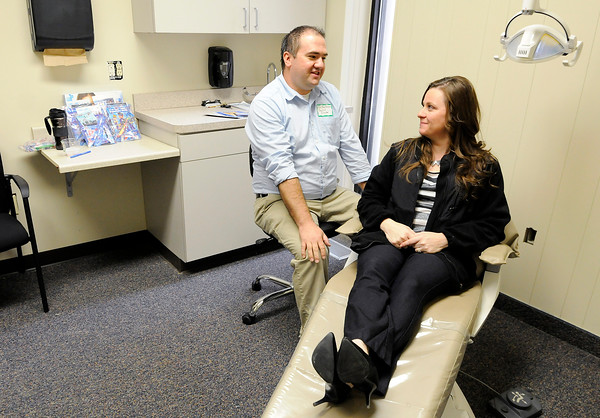 Don Knight | The Herald Bulletin<br /> Melissa Rigdon sits in the exam chair next to Dr. Jay Chilson in the dental room at the Madison County Community Health Center's Alexandria location on Friday. The center will open June 1st.