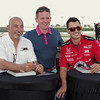 Adam Cox of Indianapolis poses for a picture with Bobby and Graham Rahal during an autograph session presented by Budweiser at Hoosier Park.