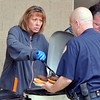 John P. Cleary | for The Herald Bulletin<br /> Pendleton Correctional Industrial Facility superintendent Wendy Knight serves up food for employees during a cookout for National Correction Employees Appreciation Week.
