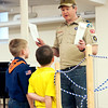 Danielle Grady | for The Herald Bulletin<br /> Jake Skinner, the scoutmaster of Anderson Cub Scout Pack 220, addresses two tiger cubs who are about to ÒcrossoverÓ and become wolf cubs. Skinner took control of the pack after Gene McMahon decided he wanted to retire.