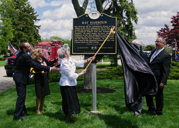 Mark Maynard   for The Herald Bulletin<br /> With help from close family friend Garic Lederman and her daughter, Vickie Bateman, Barbara Sherlin, granddaughter of inaugural Indianapolis 500 winner Ray Harroun, unveils a marker in his honor erected by the Indiana Racing Memorial Association in his honor as Anderson Memorial Park Cemetary President Jay Wildy looks on.