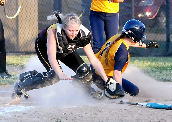 John P. Cleary | The Herald Bulletin<br /> Alexandria's catcher Emmie Gaines tries to put the tag on Shenandoah's Jessica Ballenger at home plate after Ballenger came home on a throwing error.