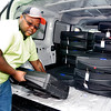 John P. Cleary | for The Herald Bulletin<br /> Madison County Highway Department employee DeAndre Perry unloads voting  machines at the New Life Church of the Nazarene Monday morning as county workers distributed the booths to all 112 voting sites around the county.