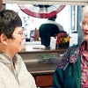 Danielle Grady | for The Herald Bulletin<br /> Alice Coats talks with Opal Dickerson, another H.O.P.E Center volunteer. They have both been working at the center around the time it first opened in June 2011.