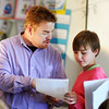 John P. Cleary | The Herald Bulletin<br /> Valley Grove Elementary 4th grade teacher J.T. Morgan answers students questions as they work on their math problems.  Morgan was named the elementary Max Beigh Enriching Education Award winner.