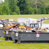 Don Knight | The Herald Bulletin<br /> Dumpsters are lined up at Athletic Park for Anderson residents to drop off items during the 31st Annual Rev. J.T. Menifee Citywide Clean-up on Saturday.