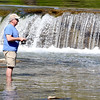 John P. Cleary | The Herald Bulletin<br /> Bob Bantz of Pendleton gets out in the waters to try his luck at fishing Thursday afternoon in Fall Creek below the falls in Falls Park.