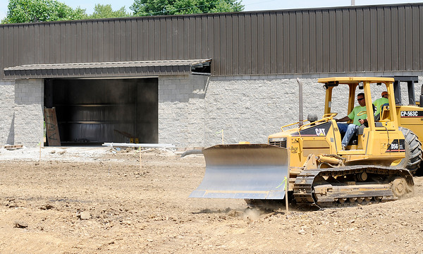 Don Knight | The Herald Bulletin<br /> A bulldozer grades dirt in the future parking lot of the new Dollar General being built on Broadway in Anderson on Tuesday. According to their website the retailer is adding 900 new stores in 2016.