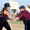 John P. Cleary | The Herald Bulletin<br /> Alexandria's Mackenzie McCarty gets congratulations from coach Lionel Martin as she heads home after hitting her first of two home runs in their sectional game against Shenandoah.