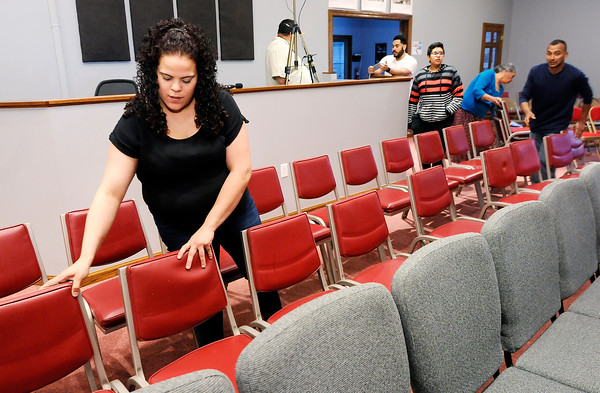 Don Knight | The Herald Bulletin<br /> Leslie Miranda arranges extra chairs at Inglesia De Dios Emanuel on Friday as the congregation prepared to celebrate their one year anniversary in Pendleton.
