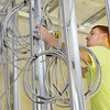 Don Knight | The Herald Bulletin<br /> Cody Butler with Fredericks installs conduit at the new Madison County dispatch center on Wednesday. The 911 dispatch center is currently located on Gene Gustin Way.