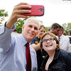 Don Knight | The Herald Bulletin<br /> Megan Stoner takes a selfie with Gov. Mike Pence during a campaign stop at Good's Candy Shop on Thursday. Pence will face Democrat John Gregg in the November election.